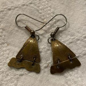 Vintage bronze earrings with etched detail.